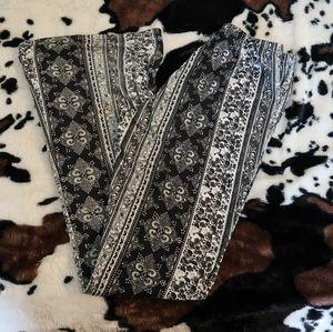 Charlotte Russe floral tapestry flare leggings